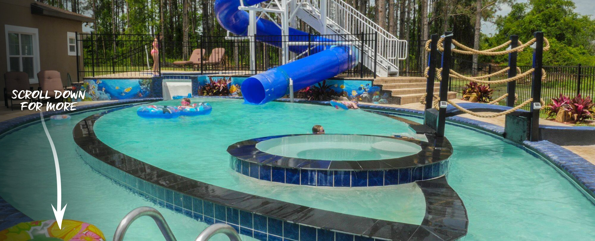 The Great Ecscape Lakeside's (vacation rental home) GO FISH pool and lazy river with home waterslide!
